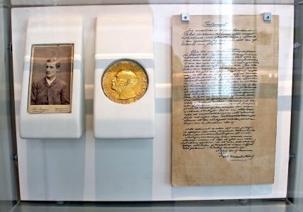 Nobel's will and testament along with the Nobel prize medal and Ragnar Sohlman, executor of his will