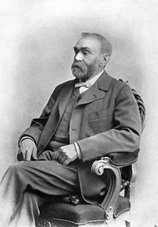 Alfred Nobel, eigentlich Alfred Bernhard Nobel (1833-1896), schwedischer Chemiker und Erfinder. Es wurden ihm insgesamt 355 Patente zugesprochen. Erfinder des Dynamits und Stifter des Nobelpreises. /Mann in Stuhl sitzen, Vollbart, nachdenklich, Personen, Portrait, Porträt Dostawca: PAP/picture-alliance / dpa
